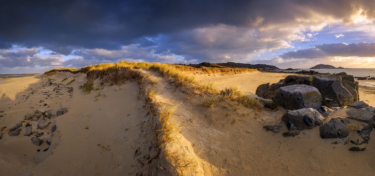 Panoramic photo of Oyster Point, Herm at sunset in winter.