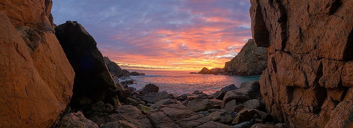 Panorama of a beautiful sunset at Le Jaonnet Bay on the south coast of Guernsey.